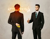 stock photo of backstabbers  - Angry businessman hiding a weapon behind his back  - JPG