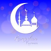 image of eid al adha  - Card in blue color for congratulations with beginning of fasting month of Ramadan as well with Islamic holiday Eid al - JPG