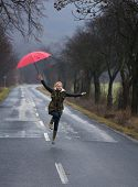 pic of rainy day  - Rainy day woman holding red umbrella - JPG