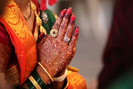 image of pray  - Folder hands of a traditional Indian bride in wedding attire praying during her wedding - JPG