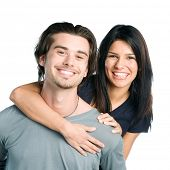 Happy smiling young latin couple piggyback isolated on white background
