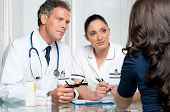 image of medical assistant  - Young female patient discuss with doctors on her medical exam at hospital - JPG