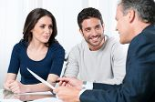 image of financial  - Financial consultant presents bank investments to a young couple - JPG