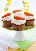 Easter  cupcakes with marzipan carrots on a cake stand