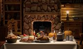 picture of cozy hearth  - A full Thanksgiving dinner on a table set in cozy cabin - JPG