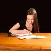 Pretty Young Woman Writing A Letter