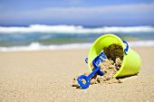 picture of spade  - Toy bucket and shovel on a tropical island beach