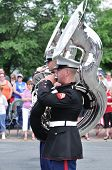 The Usmc Marine Forces Reserve Band Performers Playing Tubas In A Parade