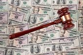 Dollar Currency notes with gavel. Legal costs - Geric