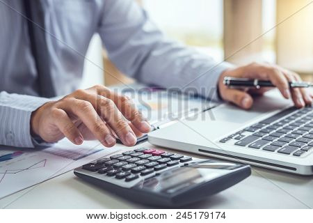 poster of Business Man Or Accountant Working Financial Investment On Calculator With Calculate Analyze Busines
