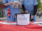 A donation bucket to save the NHS during the Protest against NHS reforms in Exeter