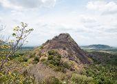 Scorched Hill Near Dambulla Cave Temple, Sri Lanka During Drought Season poster