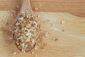 Close Up Natural Brown Sugar Or No Bleach Sugar On Wooden Spoon. Organic Brown Sugar Put On Wood Tab poster