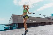 Fit Fitness Woman Doing Fitness Exercises Outdoors At City. Girl Doing Exercise With Jump Rope. Fema poster