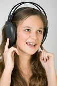 Young Pretty Caucasian Girl With Headphones Listen Music