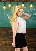 Sexy Teacher Concept. Teacher With Waving Long Blonde Hair Looks Sexy. Lady Strict Teacher On Dreamy poster