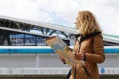 Woman Tourist Holding A Tourist Map Of Kazan. poster
