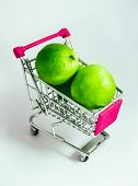 Metal Basket With A Fresh Green Lime In It. Food Vegetable Consumption, Shopping Concept, Pushcart. poster