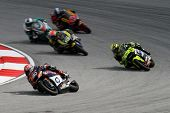 SEPANG, MALAYSIA - OCTOBER 22: Moto2 rider Axel Pons (80) competes with other riders at qualifying r