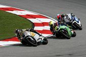 SEPANG, MALAYSIA - OCTOBER 22: Moto2 rider Thomas Luthi (12) competes with other riders at qualifyin