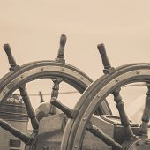 Closeup Of Helm Rudder On Ship Or Yacht, Ship Wooden Old Steering Wheel poster