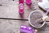 Dry Lavender Buds Bowl, Sachet Wit Lavender  And Bottles With Cosmetics On Vintage Wooden Background poster