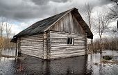 old rural house in water