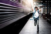 Traveler Man Running After A Moving Train From A Railway Station poster