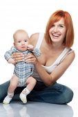 Beautiful redhead woman with her child.