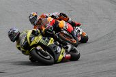 SEPANG, MALAYSIA - OCTOBER 22: MotoGP rider Andrea Dovizioso (4) chases Colin Edwards during the She