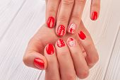 Female Hands With Beautiful Designed Manicure. Young Woman Gentle Manicured Hands With Red Hearts An poster