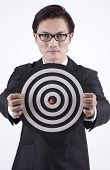 Confident Businessman With Bull's Eye