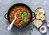 Vegetarian Mushrooms Chickpea Stew In A Iron Pan And Rustic Grilled Bread On A Gray Background, Top  poster