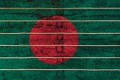 National Flag  Of Bangladesh  On A Wooden Wall Background. The Concept Of National Pride And A Symbo poster