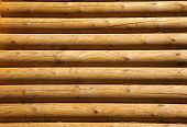 stock photo of log fence  - Wall of the rural house from wooden logs - JPG