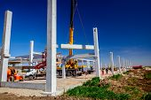 Mobile Crane Is Operating And Worker Is Assembly Concrete Joist In High Place. Height Worker Is Plac poster