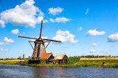 Famous Windmills In Kinderdijk Village In Holland. Colorful Spring Rural Landscape In Netherlands, E poster