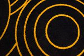 Black Carpet Macro With Orange Pattern. Black And Orange Wool Carpet. poster
