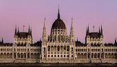Close-up On The He Hungarian Parliament Building In Symmetry After Sunset With Beautiful Sky. poster