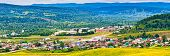 Panoramic View From Hill To Plain With Small Town In Summer Cloudy Day. Picturesque Urban Landscape poster