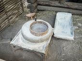 Rotary Discoid Mill Stone For Hand-grinding A Grain Into Flour. Medieval Hand-driven Millstone Grind poster