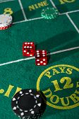 stock photo of crap  - Craps table with casino chips and dice - JPG