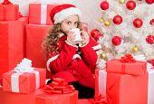 Kid Santa Hat Enjoy Hot Beverage. Yummy Warm Drinks For Kids. Girl Little Adorable Child Hold Mug Wi poster