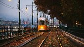 A Yellow Tram Travels On Route Number 2 Along The Banks Of The Danube. Cloudy Autumn Evening In Buda poster