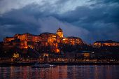 The Royal Palace Of Budapest, Buda Castle, In The Evening With Beautiful Lighting On A Background Of poster