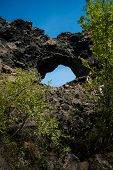 Icelandic Lava Rock Formations And Famous Hole At Dimmuborgier Black Fortresses Near Lake Myvatn. Sh poster