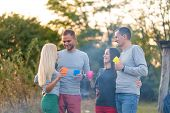Picnic With Friends By The Fire. Company Friends Having A Hike Picnic Nature Background. Friends Tel poster