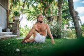 Man Practice Yoga Practice And Meditation Outdoor. poster