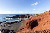 Panoramic View On The Coastline Of El Golfo With Red And Black Colored Volcanic Rock Formations And  poster
