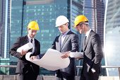 Engineering And Architecture Concept, Engineers Working On A Building Site Holding Blueprints , Arch poster